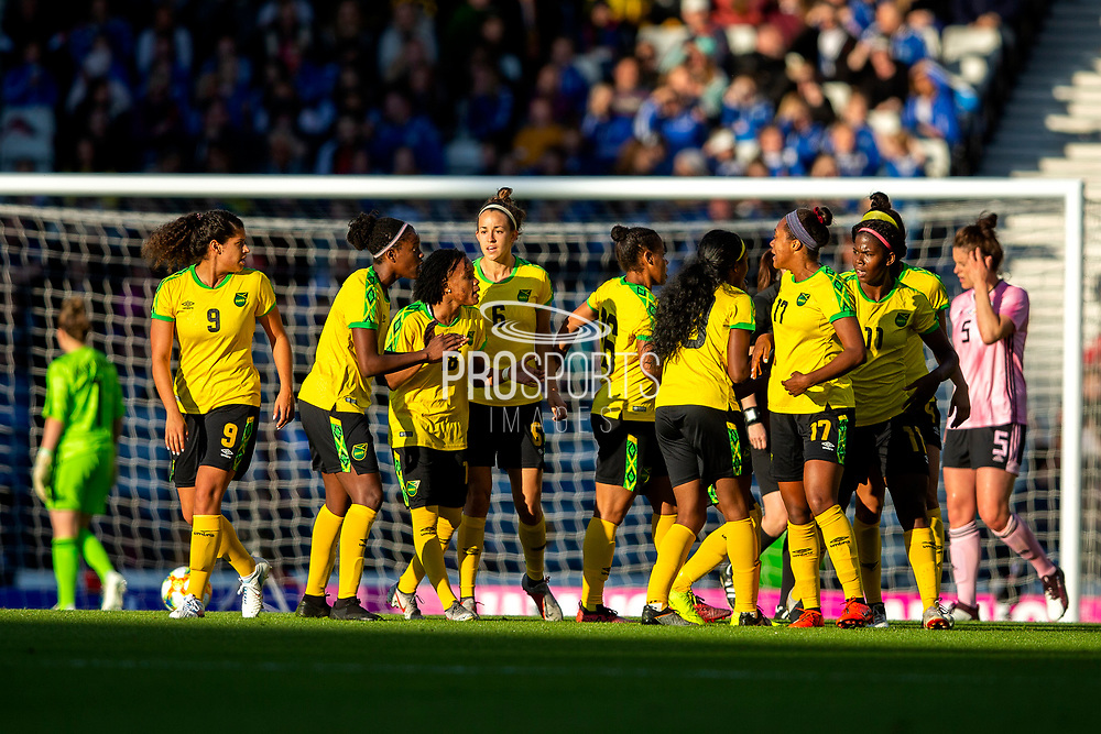 Jamaica players celebrate their first goal (0-1) scored by Khadija Shaw (#11) of Jamaica during the International Friendly match between Scotland Women and Jamaica Women at Hampden Park, Glasgow, United Kingdom on 28 May 2019.