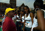 Bill Cosby talks with the Long Beach Poly High girls 4 x 100-meter relay (from left) Shalonda Solomon, Chanda Picott, Jasmine Lee and Shana Solomon after setting a national U.S. high school record of 44.50 seconds in the 110th Penn Relays at  Franklin Field on Friday, April 23, 2004 in Philadelphia.