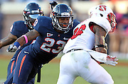 Oct. 22, 2011 - Charlottesville, Virginia - USA; Virginia Cavaliers cornerback Dom Joseph (23) tackles North Carolina State wide receiver Jay Smith (86) during an NCAA football game at the Scott Stadium. NC State defeated Virginia 28-14. (Credit Image: © Andrew Shurtleff/