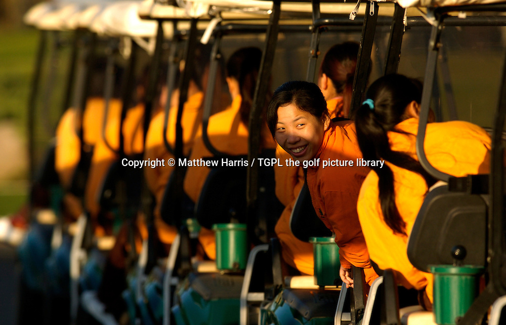 Female Chinese caddies wait on their buggies  during Johnnie Walker Asian Classic 2005, Pine Valley Golf Resort & Country Club, Changping District, Beijing, China.