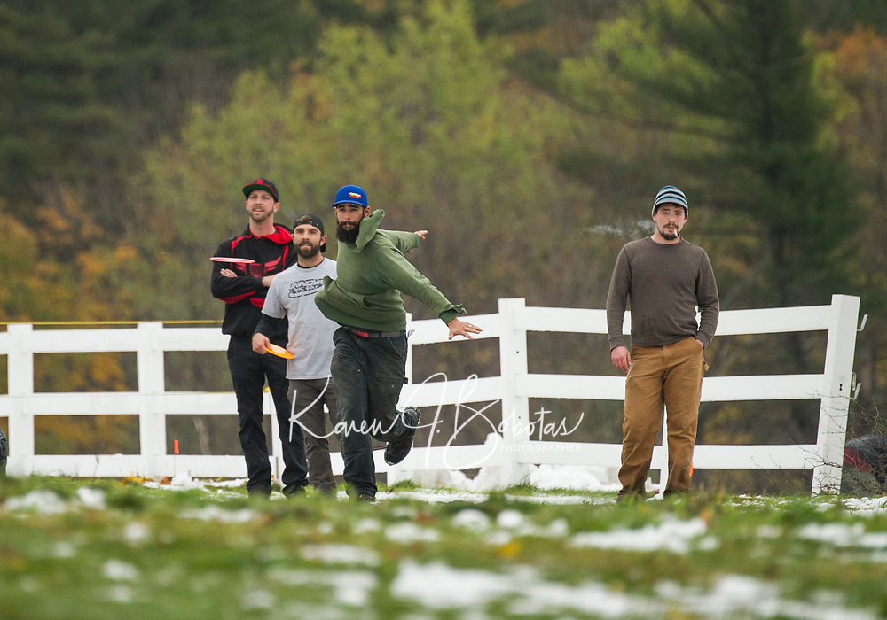 Pro teammates Steve Greene, Billy Crane, and Cody White look on as Ian Craveiro takes his first throw off from the 7th tee box during Sunday's Disc Golf Tournament at Castle in the Clouds (Michael Habets not pictured).   (Karen Bobotas/for the Laconia Daily Sun)