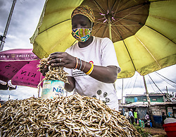 May 9, 2020, Nairobi, Kenya: A sardine vendor wearing a face mask as a precaution during the corona virus pandemic..Kenya has recorded 649 confirmed cases, 207 recovered and 30 deaths to the covid 19 disease. (Credit Image: © Donwilson Odhiambo/SOPA Images via ZUMA Wire)