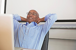 Businessman computer office smiling happy relaxed