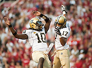 Vanderbilt quarterback Larry Smith (10) and receiver Jonathan Krause (17) celebrate after a touchdown during the first quarter of an NCAA college football game, Saturday, Oct. 30, 2010, in Fayetteville, Ark.