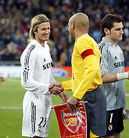 Photo: Chris Ratcliffe.<br /> Real Madrid v Arsenal. UEFA Champions League. 2nd Round, 1st Leg. 21/02/2006.<br /> David BEckham of Real Madrid and Thierry Henry of Arsenal before he game