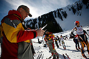 Steven St. John/Tribune..University of New Mexico head coach George Brooks checks the lineup of competitors at the New Mexico Invitational at Taos Ski Valley on Thursday, Feb. 8th, 2007...Brooks is in his 37th year as head coach New Mexico ski team and is the only coach in the history of the program. He won the only national championship in school history in 2004.