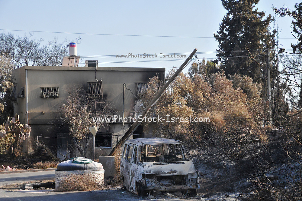 On May 23 2019, a forest fire devastated the village of Mevo Modiim, Israel. Exterior of a burnt home and car