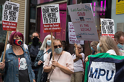 London, UK. 5th July, 2021. Health workers and supporters attend a rally organised by Doctors in Unite outside the Department of Health and Social Care. The rally was organised to mark the 73rd birthday of the National Health Service and in protest against the sale of one of the UK's biggest GP practice operators to the US health insurance group Centene Corporation.