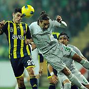 Bursaspor's Ibrahim Ozturk (R) and Fenerbahce's Ozer Hurmacı (L) during their Turkish soccer super league match Bursaspor between Fenerbahce at Ataturk Stadium in Bursa Turkey on Monday, 12 December 2010. Photo by TURKPIX