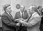 Chess Grand Masters, Clerys,Dublin,Ireland..1982.06.05.1982.05.06.1982.6th May 1982.USSR Chess Grandmaster visits Clerys. Mr Yefim Geller made a personal appearance in Clerys. Clerys sponsored the visit in conjunction with the Irish Chess Union, in agreement with the Russian Chess Federation...Mr Walls presents Mr Geller with a small memento to mark the occasion of his visit. Mr Keane looks on.