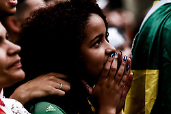 June 22, 2018 - Sao Paulo, Brazil - fans dressed in national colors who watch a big screen in the Fan Fest arena in the Anhangabau Valley, vibrate and celebrate the victory of Brazil over Costa Rica in the Fifa Wolrd Cup 2018 (Credit Image: © Dario Oliveira via ZUMA Wire)