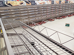 © Licensed to London News Pictures. 18/03/2020. Salford, UK. The Tesco branch , which normally opens until Midnight, closes two hours early as stock shortages become evident . An empty box beside a spillage and a misplaced avocado stand alone in a branch of Tesco in Salford which has sold out of all stock of all bread products , as customers panic buy essentials , including toilet paper, pasta and hand sanitiser , in fear of a lockdown and shortages . Today the British Government announced further measures to combat the spread of Coronavirus ( COVID-19 ) , including school closures and further state support for those affected . Photo credit: Joel Goodman/LNP