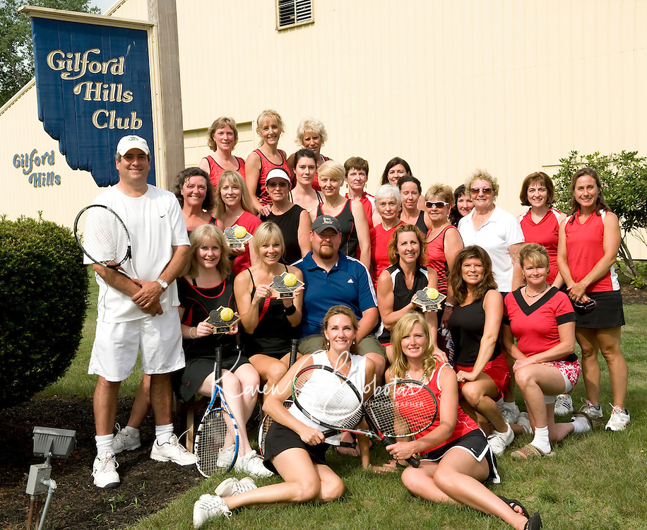 Gilford Hills Club champions and finalists from the New Hampshire Indoor Tennis League travel teams have qualified to compete in the USTA district championships for New Hampshire in August.  Front row (l-r) Kathy Peverly, Leslie Lovely.  Second row: Coach Curt Chesley, Captain Molly Joyce, Captain Pam Halsey, Coach Adam Angle, Captain Melanie Roy-Tripp, Caroline Hunter, Sue Brown.  Third row:  Co-Captain Sally Kiely, Lorien Garden, Kim Skonleczny, Sonya Workman, Co-Captain Kim Corsack, Jacinta Cullen, Sandra Caulfield, Carolyn Dickey, Stacie Buttinger, Toots Genova, Jill Lieberman, Janet Neff, Nancy Tothill, Bridget O'Brian.  Top row:  Joanie Murray, Linda Nicolai, Nancy Murray.   (Karen Bobotas/for the Laconia Daily Sun).