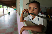 A youngsters looks out the window of his classroom a the Escuela Cardinal Oscar Andres Rodrigues in Guaimaca, Honduras. Even though Honduras has 94% school enrolment, only 40% complete their schooling.   Honduras is considered the third poorest country in the Western Hemisphere (Haiti, Nicaragua). With over 50% of the population living below the poverty line and 28% unemployed, Hondurans frequently turn to illegal immigration as a solution to their desperate situation. The Department of Homeland Security has noted an 95% increase in illegal immigrants coming from Honduras between 2000 and 2009, the largest increase of any country.