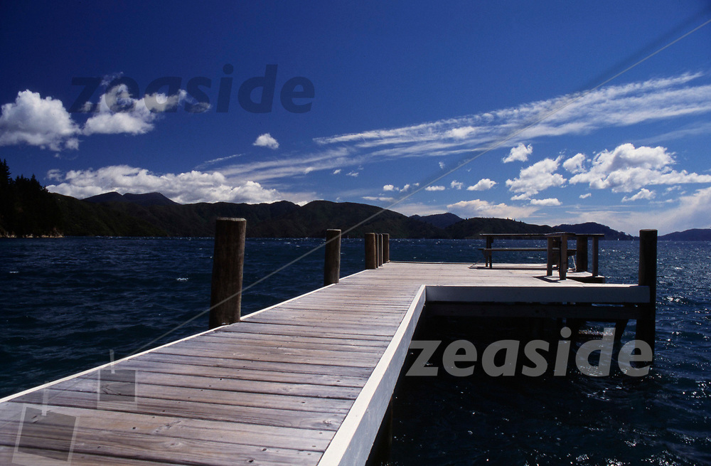 The Lazy Fish used to be a very unique and laid back Backpacker house, out in the Marlborough Sounds. Access to it was by boat exlusively. It used to have a red british phone booth with a Fish atop that would point out the wind direction, called the Telephisch. Here is the Jetty without the Telephish - which was in repair at the time this image was taken. Nowadays it is just one of those luxury retreats for the wealthy only.