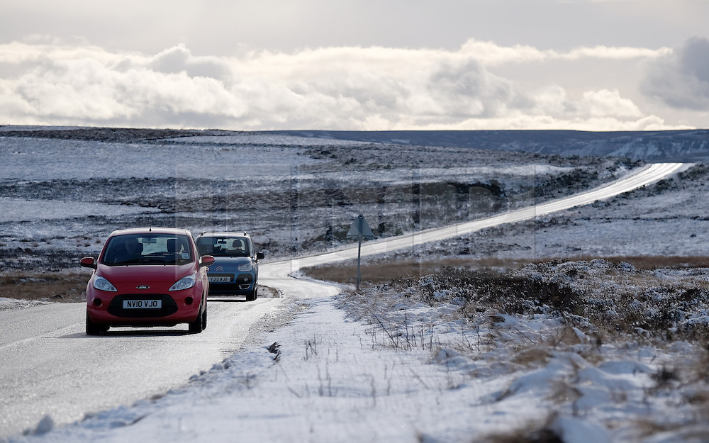 © Licensed to London News Pictures. <br /> 29/01/2015. <br /> <br /> Danby, United Kingdom<br /> <br /> Drivers make their way across a slippery moor road near Danby in North Yorkshire following overnight snow. A wintery blast causing extremely cold weather is expected to cause some disruption over the next few days.<br /> <br /> Photo credit : Ian Forsyth/LNP