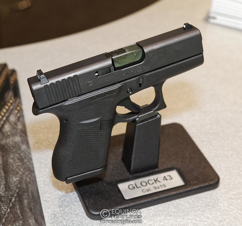 London, United Kingdom - 16 September 2015<br /> Glock hand guns including the Glock 17 gen 4 model which is supplied to the UK Ministry of Defence, on display at the annual defence and security exhibition DSEI at ExCeL, Woolwich, London, England, UK.<br /> (photo by: EQUINOXFEATURES.COM)<br /> <br /> Picture Data:<br /> Photographer: Equinox Features<br /> Copyright: ©2015 Equinox Licensing Ltd. +448700 780000<br /> Contact: Equinox Features<br /> Date Taken: 20150916<br /> Time Taken: 11125760<br /> www.newspics.com