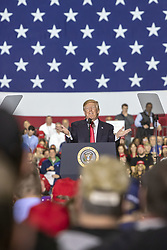 April 28, 2018 - Macomb, Michigan, U.S. - President Donald Trump speaks at a campaign-style rally in Macomb. Trump skipped the annual White House Correspondents' Association dinner to travel to Michigan. (Credit Image: © Jim West via ZUMA Wire)