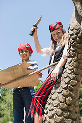 Two girls standing on pirate ship in a adventure playground, Bavaria, Germany