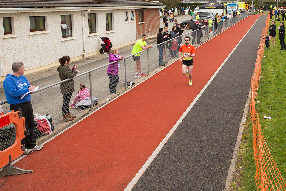 Bohermeen AC 10km & Half Marathon Road Races, 12th March 2016<br /> Star of the Sea athlete - Eoin Callaghan crosses the finish line to win the Bohermeen AC Half Marathon Road Race<br /> <br /> Photo: David Mullen /www.cyberimages.net / 2016