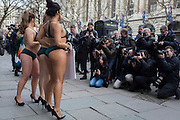 "Lingerie-clad models stage a protest by the animal rights organisation, Peta against the suffering of animals, on 17th Febriary 2017, in London, England, United Kingdom. The group stripped off into matching green underwear and crocodile masks before posing outside the show's main venue on the Strand in central London. Peta is campaigning against the use of exotic animal skins in the fashion industry. It follows an investigation of crocodile farms which found animals were confined to pits and sometimes still alive when their skin was torn off, Peta said. London Fashion Week is a clothing trade show held in London twice each year, in February and September. It is one of the ""Big Four"" fashion weeks, along with the New York, Milan and Paris. The fashion sector plays a significant role in the UK economy with London Fashion Week alone estimated to rake in £269 million each season. The six-day industry event allows designers to show their collections to buyers, journalists and celebrities and also maintains the city's status as a top fashion capital. (Photo by Richard Baker / In Pictures via Getty Images)"