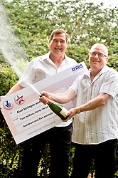 Friends of 17 years  Wally Jinks 51 and Alan Stringer 50, both from Edenthorpe,officially  became Doncasters latest Lottery millionaires on Monday (5 July 2010) . The pair matched all six numbers to scoop a cheque for £2,033,705 between them. .Wally and his wife dawn flew off on Holiday on the day of the draw and spent the whole holiday and a further six days back home unaware of thier Millionaire status  05 July 2010 .Images © Paul David Drabble.