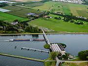 Nederland, Utrecht, Nieuwegein, 14-09-2019; Amsterdam-Rijnkanaal met plofsluis bij Jutphaas, onderdeel van de Nieuwe Hollandse Waterlinie. De voorziening diende om het kanaal af te kunnen dammen, een explosie met dynamiet zou de inhoud van de betonnen bak - zand en grind - in het kanaal doen belanden. Toenemende scheepvaart leidde er toe dat het kanaal om de sluis heen geleid werd. <br />  'Plof' sluice, explosion sluice, Dutch defense line; the installation was build to obstruct the canal: explosives would cause the sand and gravel from the concrete reservoirs to fall in the canal.<br /> <br /> luchtfoto (toeslag op standard tarieven);<br /> aerial photo (additional fee required);<br /> copyright foto/photo Siebe Swart
