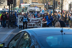 "London, March 7th 2017. Disabled protesters block the traffic in Parliament Square as they demonstrate against ""the latest underhand cuts to Personal Independence Payment regulations announced by Penny Mordaunt, the Minister of Disability, Work and Health which will lead to the ineligibility of a further 160,000 disabled claimants, mainly with mental health conditions""."