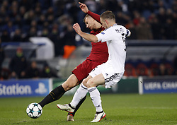 December 5, 2017 - Rome, Italy - Roma s Edin Dzeko, left, is challenged by Qarabag s Maksim Medvedev during the Champions League Group C soccer match between Roma and Qarabag at the Olympic stadium. Roma won 1-0 to reach the round of 16. (Credit Image: © Riccardo De Luca/Pacific Press via ZUMA Wire)