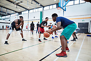 DUBLIN, IRELAND - August 13, 2018:  Ireland basketball was awaiting for Aidan's return back home so they had put together a week long series of clinic's and exhibition games that he would be featured in. Ireland is not historically known for basketball so seeing Aidan's success has provided the country and athletes hope. <br /> <br /> Aidan is here working on two-ball concentration drills with players.<br /> <br /> Photo by: Johnnie Izquierdo