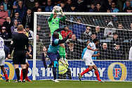 Adebayo Akinfenwa of Wycombe Wanderers collides with Craig MacGillivray of Portsmouth during the EFL Sky Bet League 1 match between Wycombe Wanderers and Portsmouth at Adams Park, High Wycombe, England on 6 April 2019.