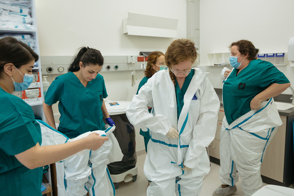 Dr. Limor Rubin (2nd R) and nurses put on protective gear, as they prepare to enter an isolated ward to treat Covid-19 Novel Coronavirus patients, at the Hadassah Ein Kerem Hospital, in Jerusalem, Israel, on April 20, 2020.