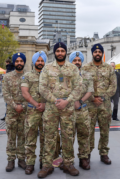 © Licensed to London News Pictures. 27/04/2019. LONDON, UK.  Members of the British Armed Forces Sikh Association pose for a photo during the festival of Vaisakhi in Trafalgar Square, hosted by the Mayor of London.  For Sikhs and Punjabis, the festival celebrates the spring harvest and commemorates the founding of the Khalsa community over 300 years ago.  Photo credit: Stephen Chung/LNP