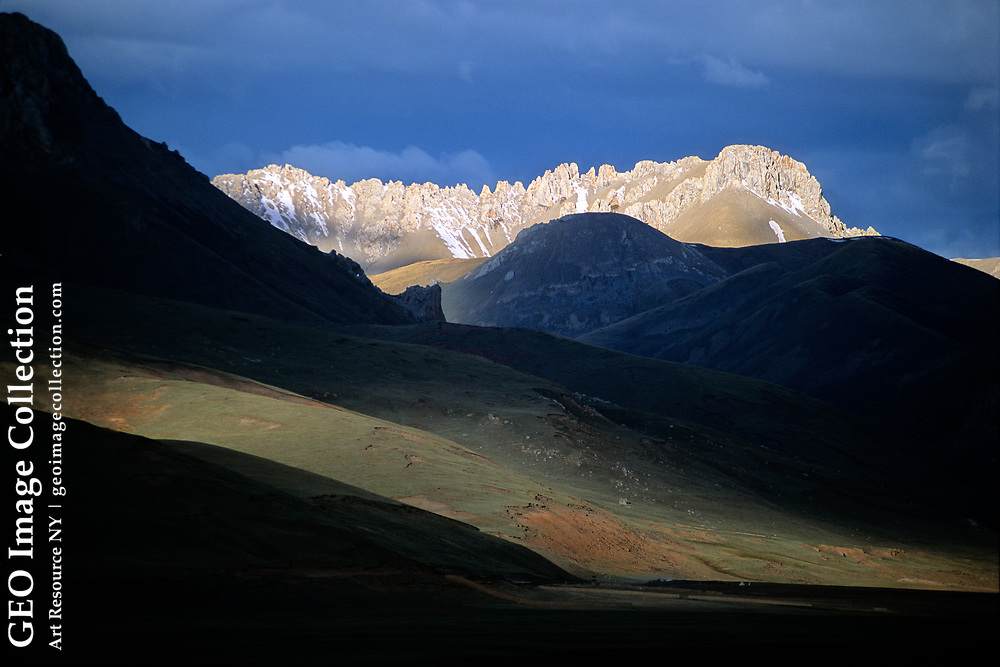 Dawn breaks over the Tibetan Plateau, the Roof of the World, where the three great rivers of Asia — the Salween, Mekong and Yangtze — get their start at 17,490 feet.  Zadoi, Qinghai, China