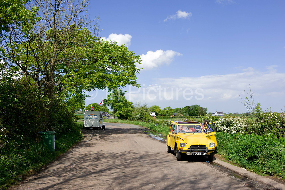A burger van and Citroën CV parked in a rural layby on the 09th May 2011 near Newcastle in the United Kingdom.