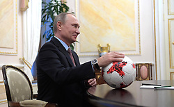 November 25, 2016 - Moscow, Russia - Russian President Vladimir Putin holds a soccer ball given him by FIFA president Giovanni Infantino during their meeting at the Kremlin November 25, 2016 in Moscow, Russia. (Credit Image: © Sergey Guneev/Planet Pix via ZUMA Wire)