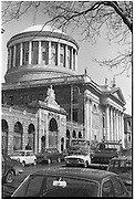 "The Four Courts..1971..16.04.1971..04.16.1971..16th April 1971..The Four Courts,for centuries,has been the centre of Ireland's Judicial system..Work based on the designs of Thomas Cooley, architect of the Royal Exchange (now City Hall), began in 1776. Cooley's building concentrated in the area of the west courtyard and was intended to house only the Public Records Office and King's Inns. When Cooley died in 1784, James Gandon, architect of the Custom House, was appointed to add the courts to the plan. Into his completed design he incorporated Cooley's building, adding two quadrangles and a central block. The quadrangles were given to the record and legal offices, the centre to the four courts of Chancery, Exchequer, Kings Bench and Common Pleas. At the hub is the Round Hall, 64ft in diameter, with inner and outer domes and a surround of Corinthian columns. It was once described as ""both the physical and spiritual centre of the building""(www.courts.ie/courts.ie/library3.).Throughout the years the courts have been damaged ,destroyed and rebuilt as a result of rebellion and the Irish civil war..A photograph of the Four Courts showing the dome and the collanaded front of the building."