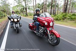 Sam Dando (R) and AJ Smith of Indian Motorcycles ride their 2017 Indian Chieftain motorcycles through Tamoka State Park during Daytona Beach Bike Week. FL. USA. Monday March 13, 2017. Photography ©2017 Michael Lichter.
