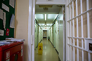 Looking down an empty corridor on B wing inside HMP Downview, Surrey, United Kingdom. HMP Downview is a women's closed category prison for adult sentenced women and convicted and remand female young people located on the outskirts of Banstead in Surrey, England. (Picture credit: © Andy Aitchison)