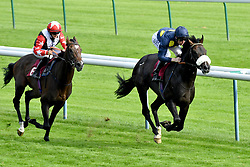 Across Dubai ridden by Pat Cosgrove (right) wins the The Cash Out At Bet365 Handicap Stakes during bet365 Old Newton Cup Day at Haydock Park Racecourse.