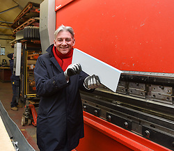 Pictured: Richard Leonard has a go on one of the machines used to bend pipework.<br /> <br /> Scottish Labour leader Richard Leonard visited an air conditioning company in Midlothian with Labour's candidate in the Midlothian seat, Danielle Rowley.<br /> <br /> © Dave Johnston / EEm