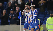 Goal scorer Brighton winger, Jamie Murphy (15) celebrates with Brighton defender Liam Ridgewell (33) and Brighton striker (on loan from Manchester United), James Wilson (21) during the Sky Bet Championship match between Brighton and Hove Albion and Brentford at the American Express Community Stadium, Brighton and Hove, England on 5 February 2016.