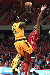 22 January 2014: Cleanthony Early takes a shot over defender Reggie Lynch  during an NCAA Missouri Valley Conference mens basketball game between the Shockers of Wichita Stat and the Illinois State Redbirds  in Redbird Arena, Normal IL.