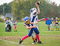 Gilford's Tom Hart makes a tackle on Interlakes Joshua Blundo during NHIAA Division III Football Saturday afternoon.  (Karen Bobotas/for the Laconia Daily Sun)