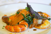 grilled prawns with salad and carrot crisps chateau guiraud sauternes bordeaux france