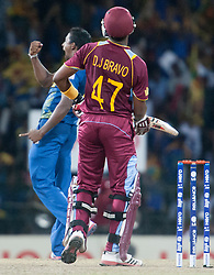 © Licensed to London News Pictures. 07/10/2012. Sri Lankan bowler Ajantha Mendis celebrates after getting the wicket of Dwayne Bravo  during the World T20 Cricket Mens Final match between Sri Lanka Vs West Indies at the R Premadasa International Cricket Stadium, Colombo. Photo credit : Asanka Brendon Ratnayake/LNP