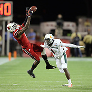 Louisville Cardinals wide receiver DeVante Parker (9) makes a reception over the head of Miami Hurricanes defensive back Artie Burns (1) during the NCAA Football Russell Athletic Bowl football game between the Louisville Cardinals and the Miami Hurricanes, at the Florida Citrus Bowl on Saturday, December 28, 2013 in Orlando, Florida. Louisville won the game by a score of 36-9. (AP Photo/Alex Menendez)
