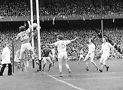 Roscommon jumps and hits the ball as it goes out of play during the All Ireland Senior Gaelic Football Semi Final Replay Roscommon v Armagh in Croke Park on the 28th August 1977. Armagh 0-15 Roscommon 0-14.