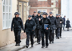 © Licensed to London News Pictures. 04/03/2019. Salisbury, UK. Police officers gather near Salisbury High Street on the first anniversary of the poisoning of former Russian spy Sergei Skripal and his daughter Yulia in March 2018. They both survived the nerve agent attack but a resident of nearby Amesbury, Dawn Sturgess, died in June 2018 after coming in contact with the poison. Two Russians have been named in connection with the attack. Photo credit: Peter Macdiarmid/LNP