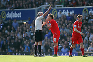 Lucas Leiva of Liverpool receives a yellow card from referee Martin Atkinson. Barclays Premier League match, Everton v Liverpool at Goodison Park in Liverpool on Sunday 4th October 2015.<br /> pic by Chris Stading, Andrew Orchard sports photography.